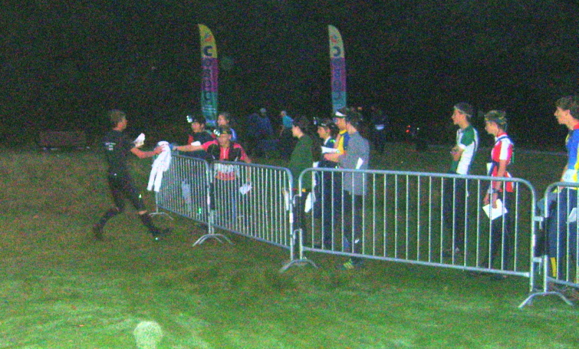 It's night, it's digitally enhanced, it's Mike handing over to Chris in 3rd place after 2 legs