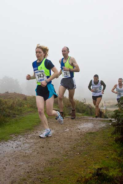 No 143 A race First Lady Olivia Renshaw tops the first climb at Maiden Castle (pic by AW)